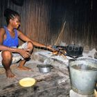local women cooking in traditional kitchen, Nosy Be Island, Madagascar